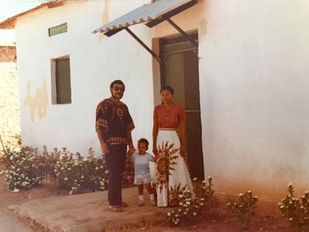 Joe & family with house